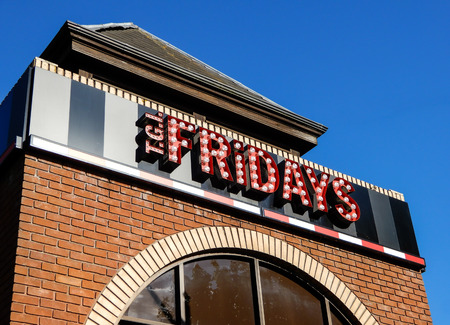 Reading, United Kingdom - June 21 2018:   Sign for TGI Fridays restaurant at The Station Shopping Park