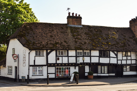 Woolhampton, United Kingdom - May 07 2018:   A Tudor style house converted into a corner shop