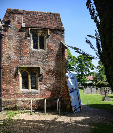Sutton Courtney, United Kingdom - May 07 2018:   A painted thermometer showing how much money has been raised in a church Appeal ouside ALl Saints Church Editorial