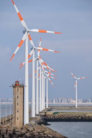 Zeebrugge, Belgium - April 28 2018:   The Wind turbines at the edge of Zeebrugge Docks Редакционное