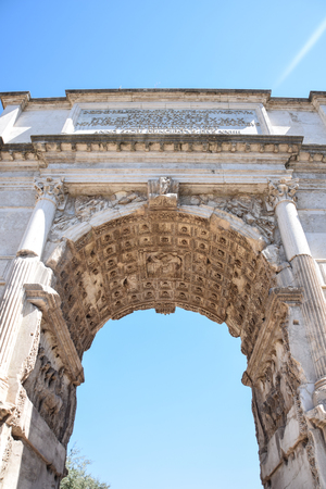 A view from beneath of Arch of Constantine on a bright summer day