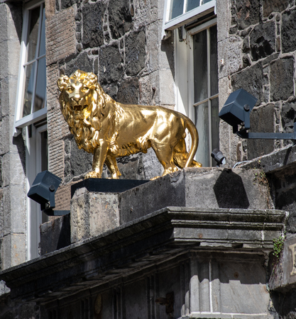 Stirling, United Kingdom - August 11 2018:   A Small Golden lion statue above the door to the Golden Lion Pub and Hotel in King Street