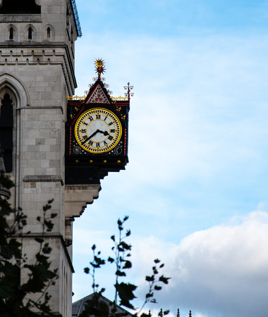 A clock hanging from the side of The Old Bailey high court building on Fleet Street