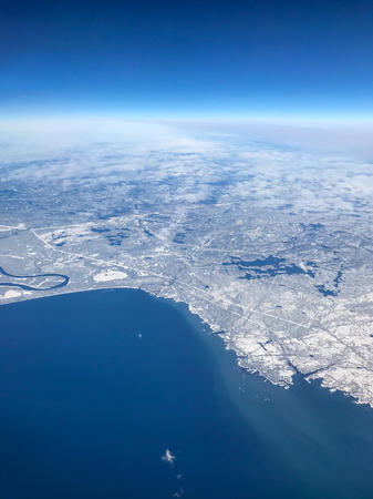 The Canadian Coast at the mouth of the St Lawrence River, photogrpahed from a plane at a height of 35000 feet