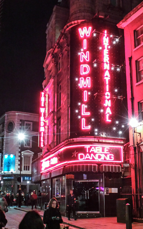 London, United Kingdom - December 15 2014:   The legendary Windmill theatre in Soho, photographed at night in Great Windmill Street