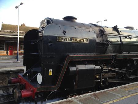 Basingstoke, United Kingdom - August 15 2012:   The Dorset Coast Express steam engine Oliver Cromwell calls in to Basingstoke railway station
