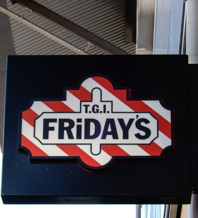 Reading, England - December 01 2017:   Hanging sign for TGI Fridays Restaurant, Oracle Waterside, Reading