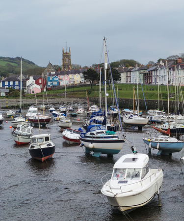 Aberaeron, United Kingdom - May 29 2013:   Boats resting on the beach at low tide 報道画像