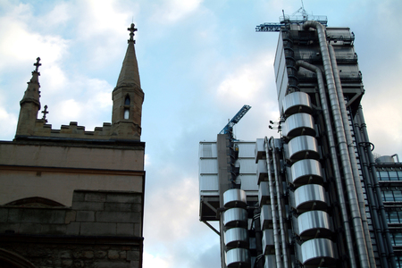 London, England - March 08 2004:   The contrasting spires of Lloyds Building and St Andrews Church tower