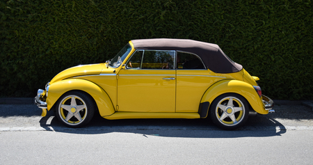 Utting, Germany - May 05 2016:   A Bright Yellow Volkswagen Beetle car Editorial
