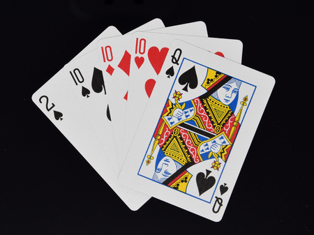 Reading, England - December 28 2017:   Three of a kind  hand in poker card game