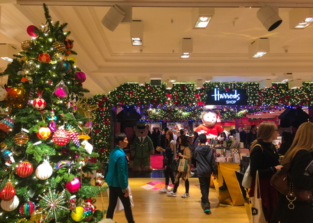 London, United Kingdom - September 20 2015:   Shoppers in the Christmas Department of the world famous Harrods department store