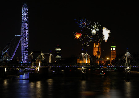 London, England - September 11 2007:   A night photo of the Millenium Eye and the Houses of Parliament with fireworks