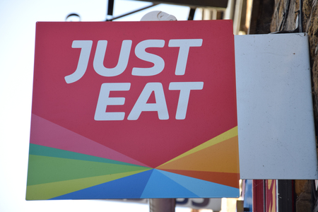 Banbury, England - November 29 2017:   Hanging sign for Just Eat web based take away food delivery service 에디토리얼