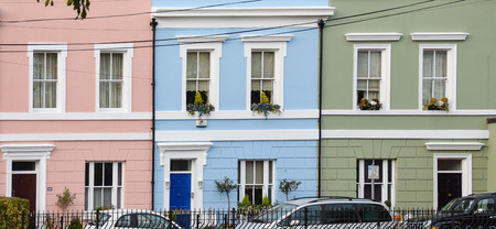 Cardiff, Wales - November 01 2017:   A row of three brightly coloured terraced houses in Cardiff, Wales