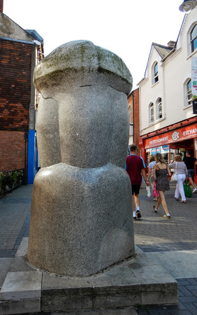 Basingstoke, United Kingdom - July 05 2018:   The sculpture Church Stone by Michael Pegler, unveiled in 1994 and known by all locals as the Wote Street Willy because of its phallic appearance