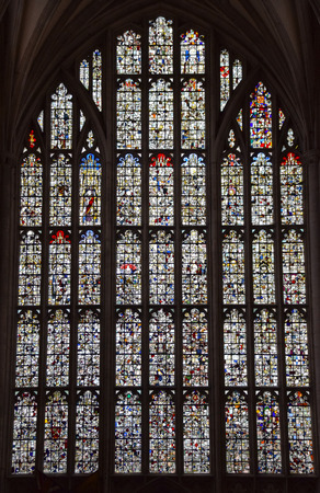 Winchester, United Kingdom - April 29 2018:   The stained glass west window of Winchester Cathedral, which was smashed by Oliver Cromwells forces during the civil war in 1642, then reassembled randoml