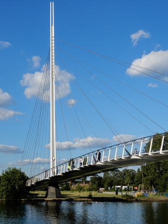 Reading, United Kingdom - June 21 2018:   The new Christchurch pedestrian suspension bridge over the River Thames ona  sunny day. Editöryel