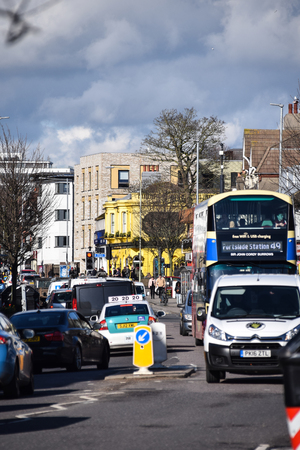 Brighton, United Kingdom - March 28 2018:   Traffic, including a number 49 bus,  going along the Lewes Road