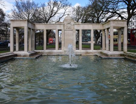 Brighton, United Kingdom - March 28 2018:   Buses drive past teh fountain in Steine Garden
