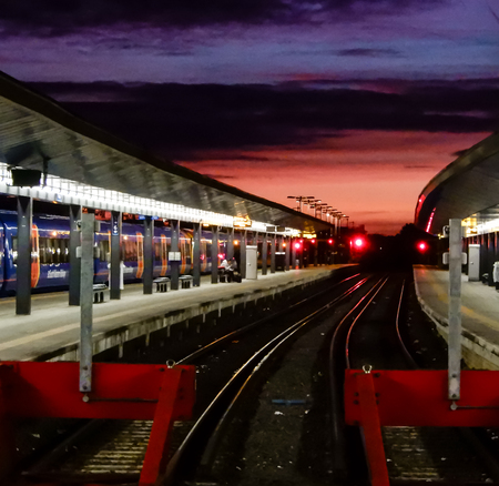 Reading, United Kingdom - October 08 2018:   The sun rises over the tracks at Reading Train Station