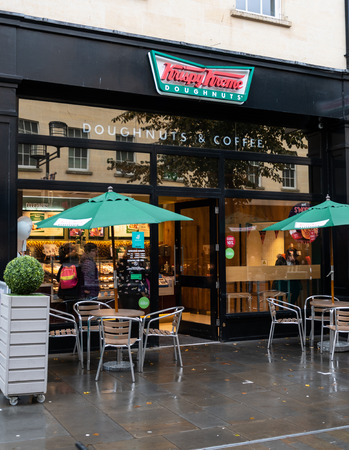 Bath, United Kingdom - October 13 2018:   The front of Krispy Kreme doughnut store on Southgate St