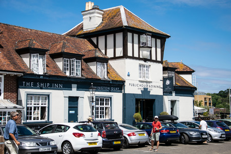 Lymington, United Kingdom - July 22 2018:   Cars parked outside of the Ship inn pub on Lymington Harbour Editorial
