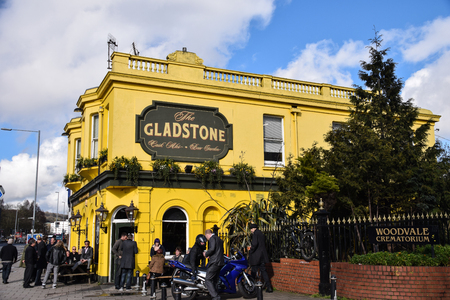 Brighton, United Kingdom - March 28 2018:   The Bright yellow painted pub The Gladstone on the Lewes Road Publikacyjne