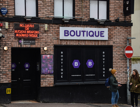 Brighton, United Kingdom - March 27 2018:   A funny neon sign over the entrance to Boutique night club in West Street Publikacyjne