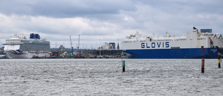 Hythe, United Kingdom - April 29 2018:   Two large but contrasting ships in dock - the luxry cruiser Britannia, and the cargo ferry ship Glovis Solomon Publikacyjne