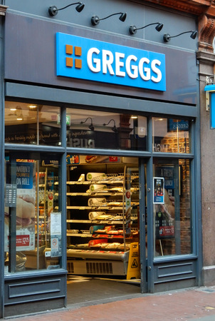 Reading, United Kingdom - April 20 2018:   The Store front of Greggs Bakery in Queen Victoria Street Publikacyjne