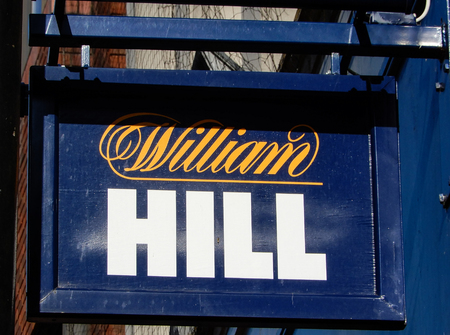 Basingstoke, United Kingdom - July 05 2018:   A Hanging Sign outside William Hill Bookmakers in London Street Publikacyjne