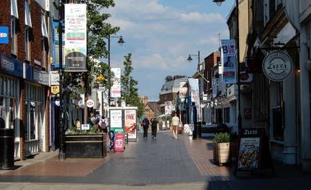 Basingstoke, United Kingdom - July 05 2018:   Shoppers wandering  down London Street shopping area