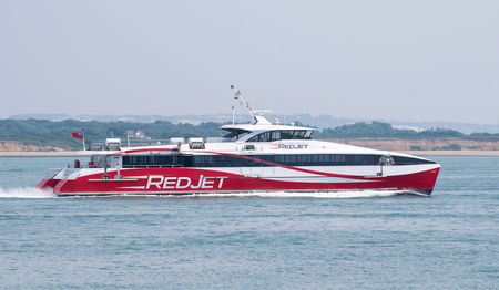 Calshot, United Kingdom - July 21 2018:   The catamaran Red Jet 6 on its passenger ferry route between Southampton and Cowes on the Isle of Wight Publikacyjne