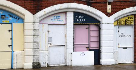 Brighton, United Kingdom - March 28 2018:   A row of boutiques on Brighton Seafront, inclding Posh Totty designs, Two Hose and Art Studio Gallery