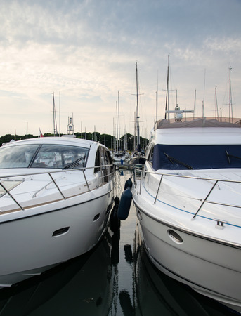 Hamble-le-Rice, United Kingdom - July 21 2018:   Two luxury cruisers tied up side by side at Hamble Point Marina Publikacyjne