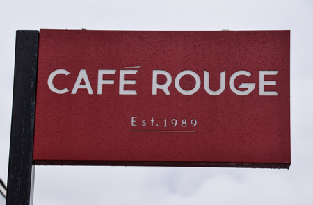 Brighton, United Kingdom - March 28 2018:   The Flag Sign for Cafe Rouge Restaurant and coffee shop at Brighton Marina