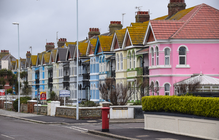Worthing, United Kingdom - March 29 2018:   A row of colourful houses on Brighton Road Publikacyjne