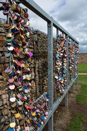 Gretna Green, United Kingdom - August 08 2018:   A collection of love locks - padlocks with personal messages on them, shaped into the word LOVE near the Famous Blacksmith wedding Venue Publikacyjne