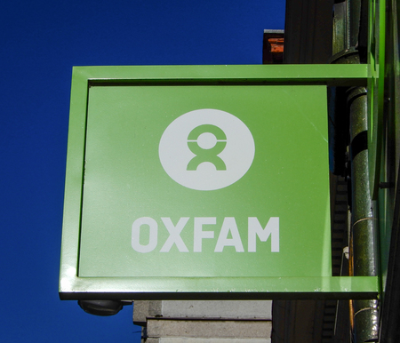 Reading, United Kingdom - February 07 2018:   Oxfam Hanging Sign in High Street