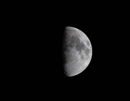A clear shot of a half moon