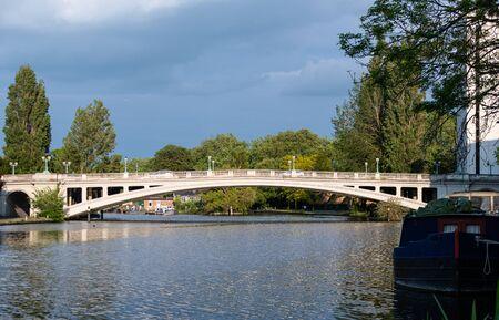 The sun shining on Reading Bridge as it crosses the Thames river Stock Photo