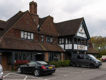Camberley, United Kingdom - April 13 2019:   The entrance to the Greene King Pub and restaurant The Ely on the A30 London Road