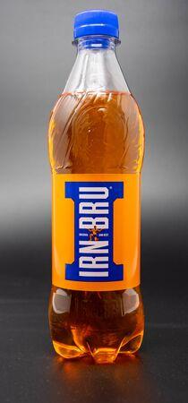 Reading, United Kingdom - April 19 2019:   A 500 Millilitre bottle of Irn-Bru scottish soft drink Редакционное