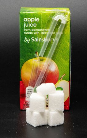 Reading, United Kingdom - April 19 2019:   Image showing that 200 millilitres of Apple Juice contains 18.4 grams of sugar Редакционное