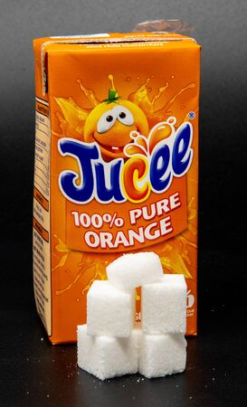 Reading, United Kingdom - April 19 2019:   Image showing that 200 millilitres of Orange Juice contains 18.4 grams of sugar