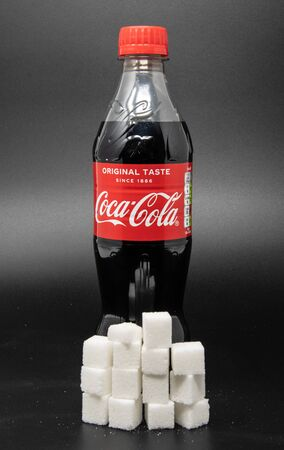 Reading, United Kingdom - April 19 2019:   Image showing that 500 Milllilitres of Coca Cola contains 54 grams of sugar