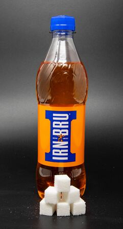 Reading, United Kingdom - April 19 2019:   Image showing that 500 millilitres of Irn-Bru contains 23.5 grams of sugar