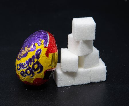 Reading, United Kingdom - April 19 2019:   Image showing that a single Cadburys creme egg  contains 28 Grams of sugar
