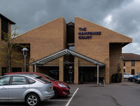 Basingstoke, United Kingdom - April 27 2019:   The main entrance to the QHotels Hampshire Court Hotel in Centre Drive Редакционное